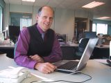 Andy Barton (at desk)